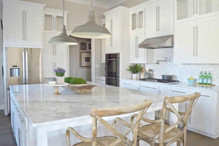 White Cabinets Against Off White Walls And Staineless Steel Appliances,  With A Hint Of Gray.