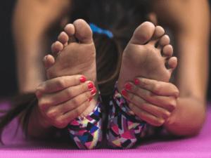safe and easy yoga poses - seated forward fold easy yoga poses